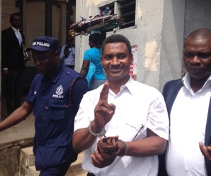Dr Ali-Gabass waving to family and supporters after the verdict