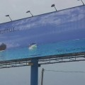 "The bottom left corner of this 2014 billboard on the Kanda Highway reads ""No visa required."""