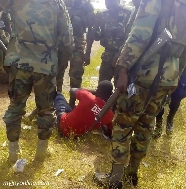 The Nanton ballot box snatcher in hands of soldiers