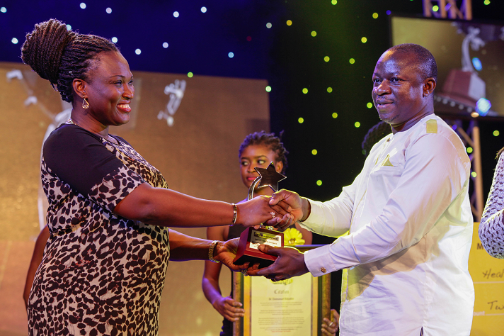 Dr. Emmanuel Bidzakin receiving his award