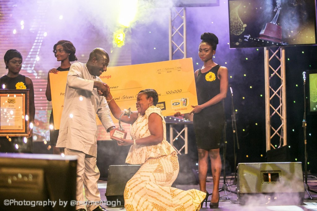 Madam Paulina Opei knelt in appreciation as CEO of MTN Ghana presented her with a trophy and a cheque of GHc100,000 for being the ultimate winner of MTN Heroes of Change Season II