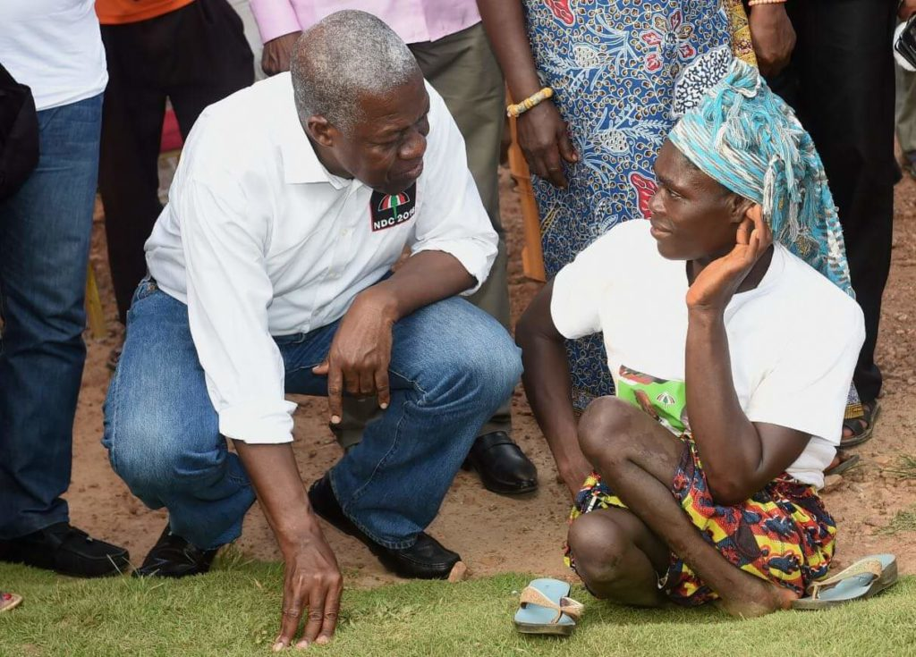Vice President Kwesi Bekoe Amissah-Arthur and a woman with physical disability