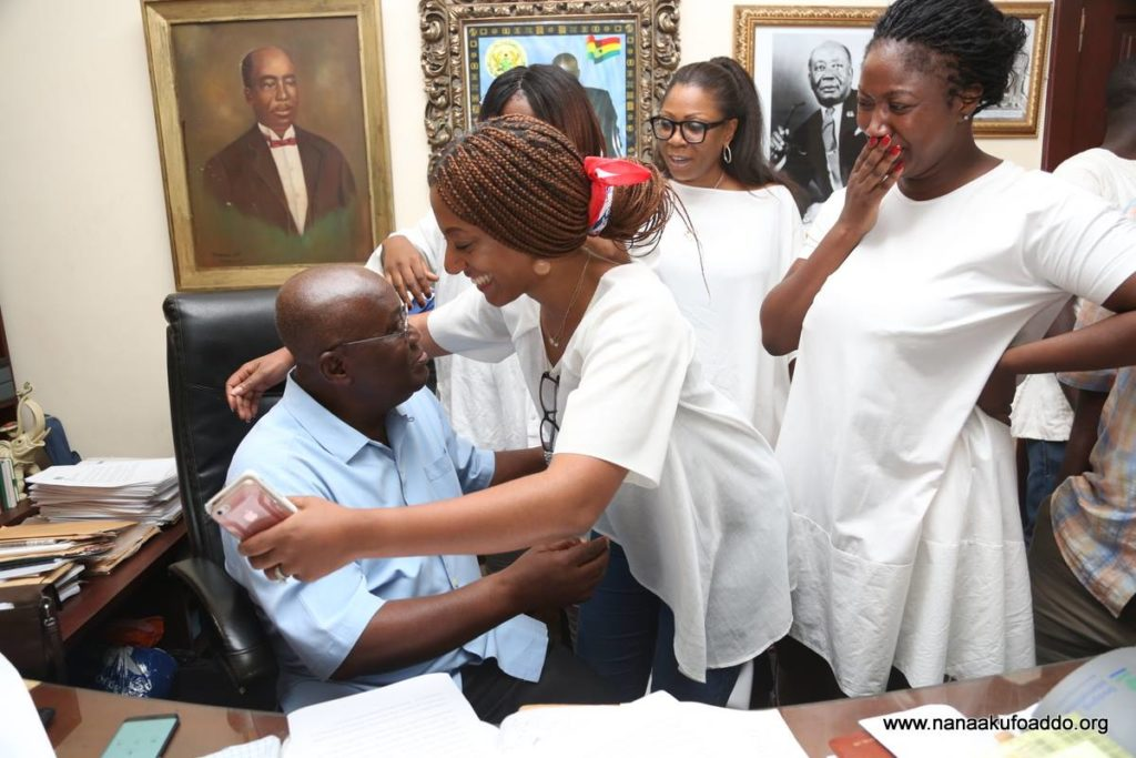 Teary Nana Dokua Akufo-Addo looks on as her sister hugs the father