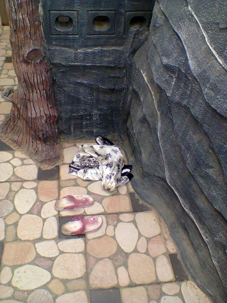 Elorm's sandals and dress by the pool
