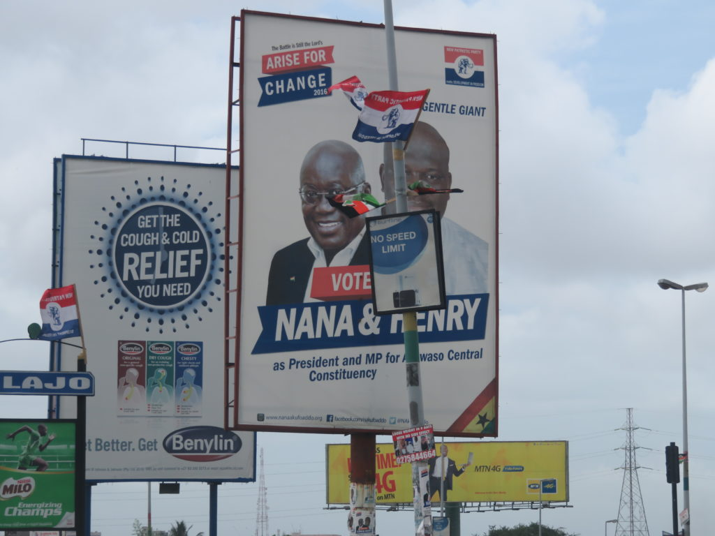 The NPP billboard of the party's flag bearer with the Ayawaso Central parliamentary candidate, Henry Quartey at Alajo junction